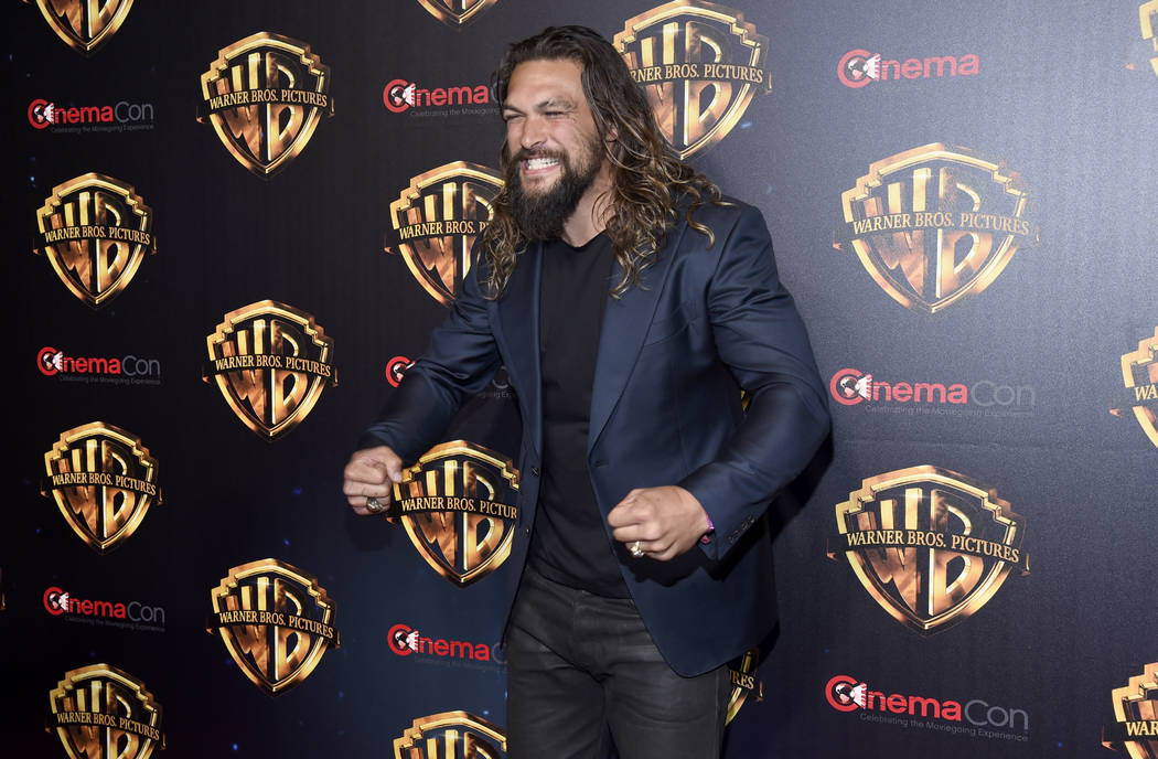 """Jason Momoa, a cast member in the upcoming film """"Aquaman,"""" arrives at the Warner Bros. presentation at CinemaCon 2018, the official convention of the National Association of Theatre Owne ..."""