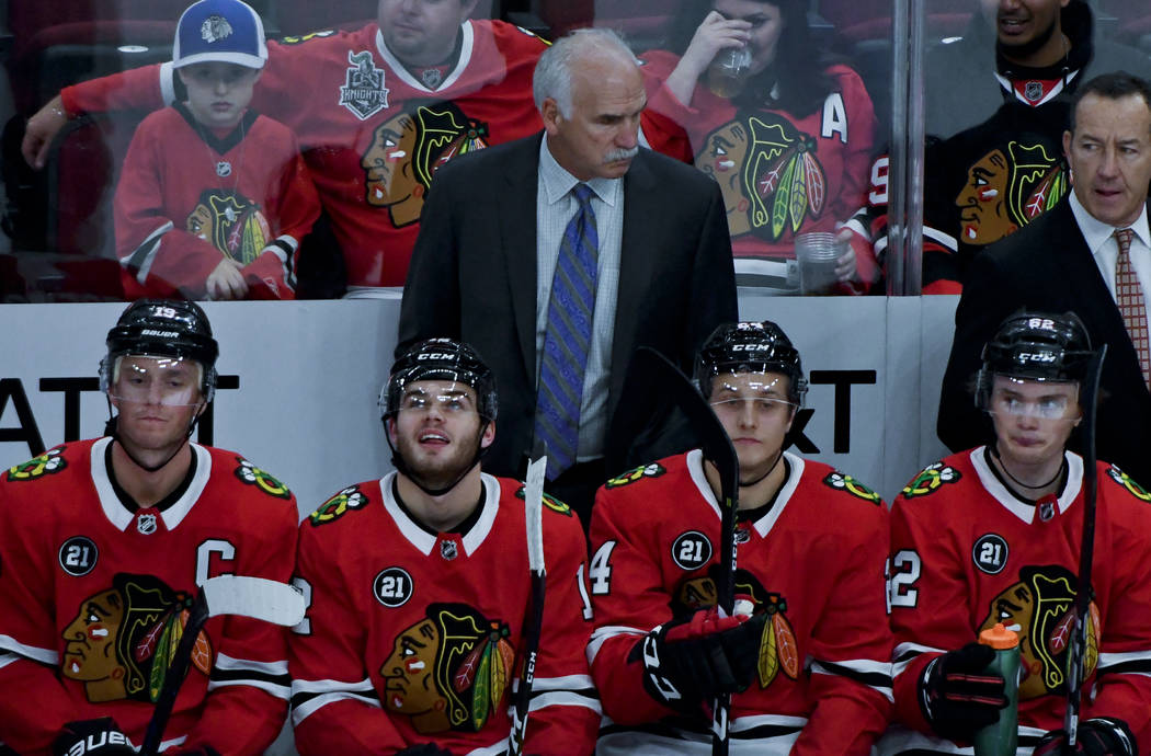 Chicago Blackhawks head coach Joel Quenneville talks with the team during the second period of an NHL hockey game against the Anaheim Ducks on Tuesday Oct. 23, 2018, in Chicago. (Matt Marton/AP)