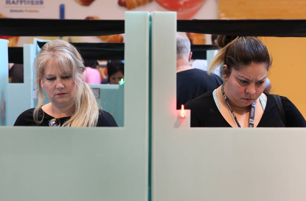 Voters, including Elisabeth Mendez, right, cast their ballots at a polling station at Galleria Mall on Tuesday, Nov. 6, 2018, in Henderson. (Bizuayehu Tesfaye/Las Vegas Review-Journal) @bizutesfaye