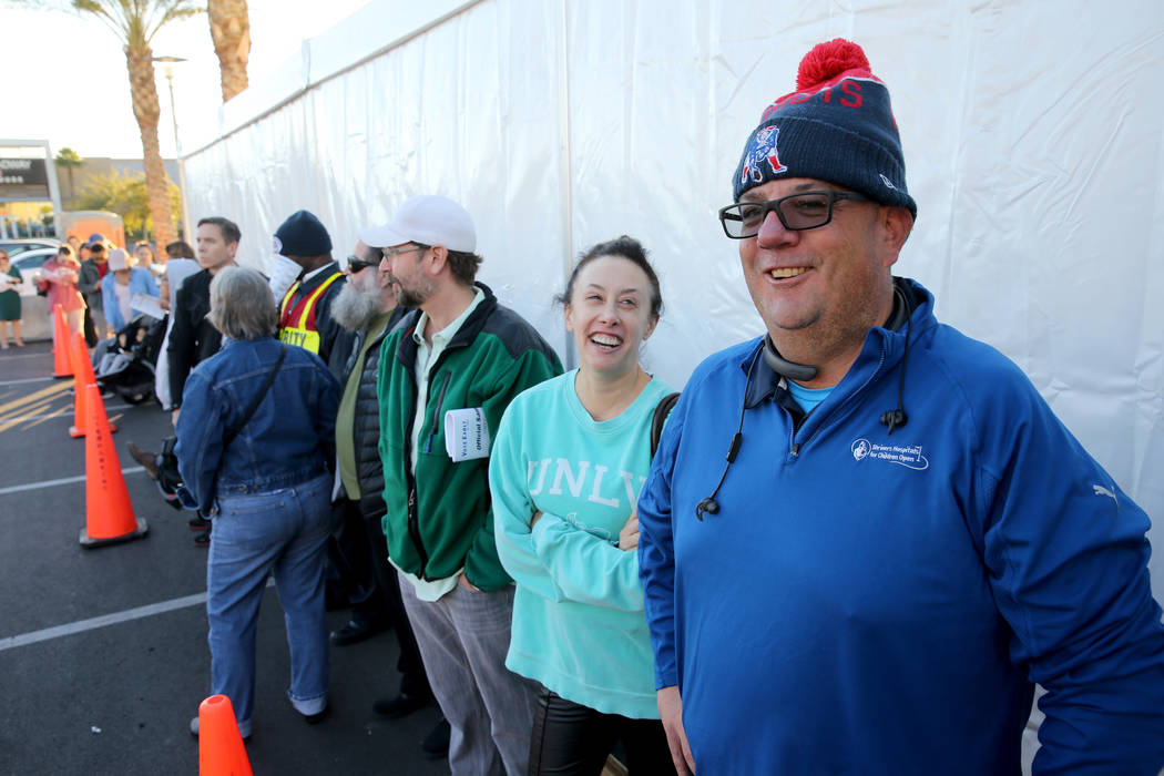 Larry P. Hickey, right, is first in line before the 7 a.m. opening of the voting center at Downtown Summerlin in Las Vegas Tuesday, Nov. 6, 2018. Hickey ended up third in line behind his wife and ...