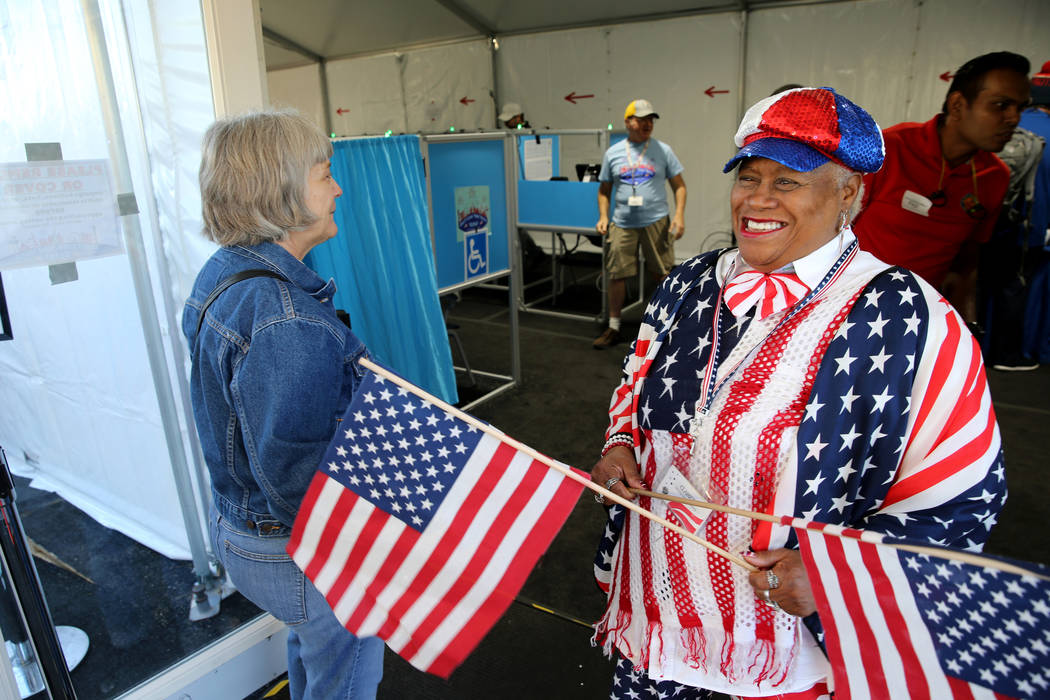 Poll worker Clarice Watkins manages the line just after opening the doors at 7 a.m. to the voting center at Downtown Summerlin in Las Vegas Tuesday, Nov. 6, 2018. K.M. Cannon Las Vegas Review-Jour ...