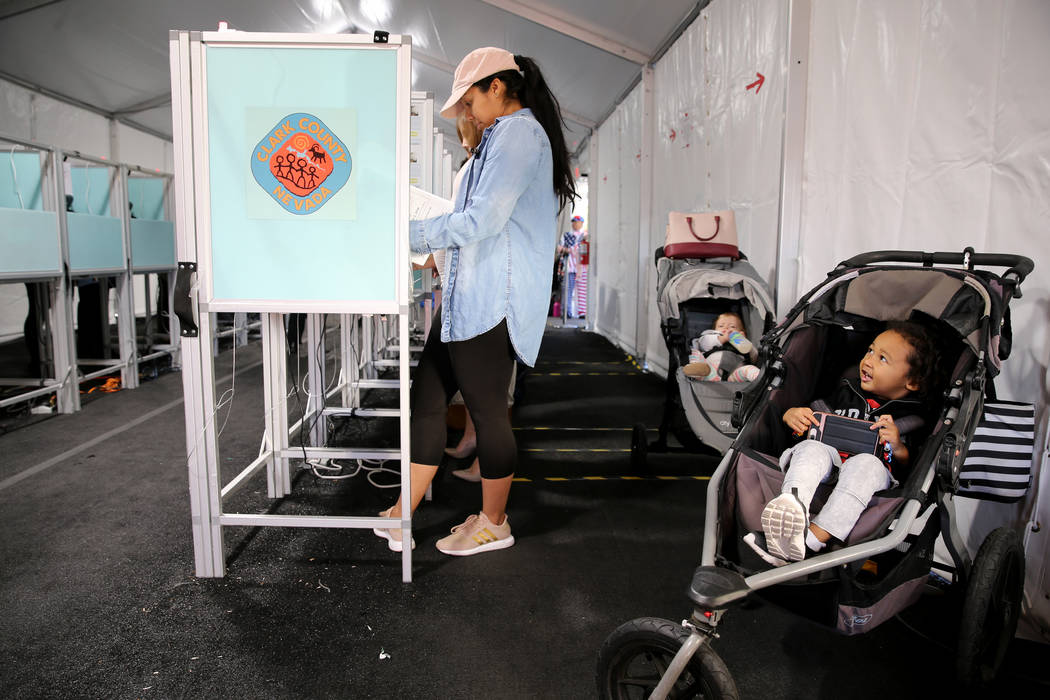 Kenzo Alston, 2, plays while his mother Megan Alston votes in the voting center at Downtown Summerlin in Las Vegas Tuesday, Nov. 6, 2018. K.M. Cannon Las Vegas Review-Journal @KMCannonPhoto