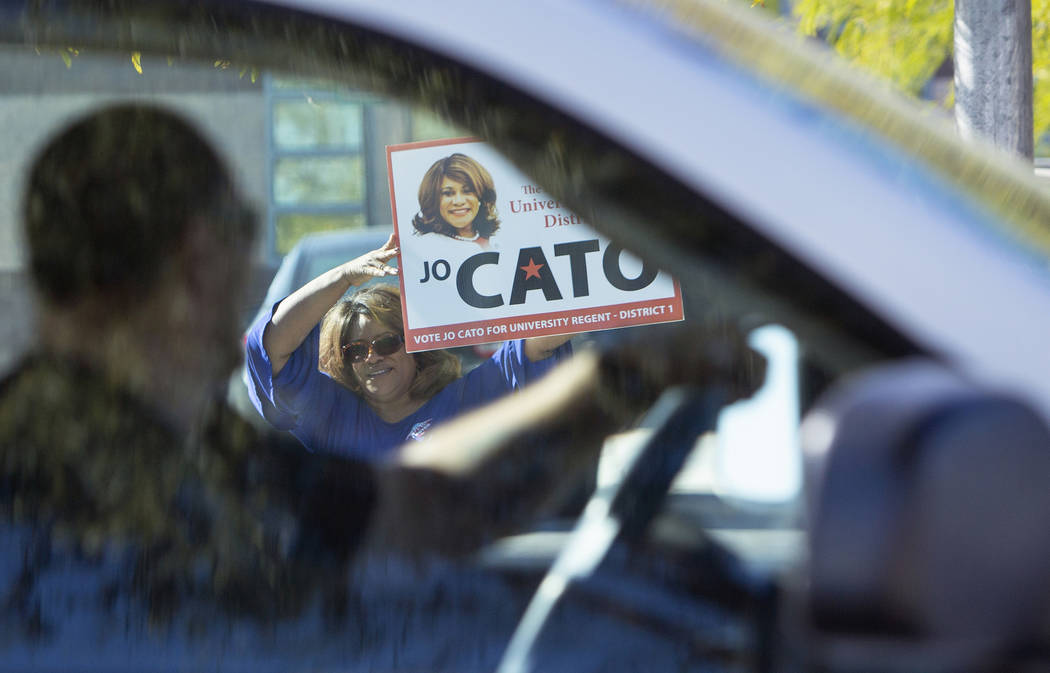 Jo Cato stands outside of a polling station at Raul Elizondo Elementary School as she campaigns for voters to chose her as University Regent in District 1 in North Las Vegas, Tuesday, Nov. 6, 2018 ...