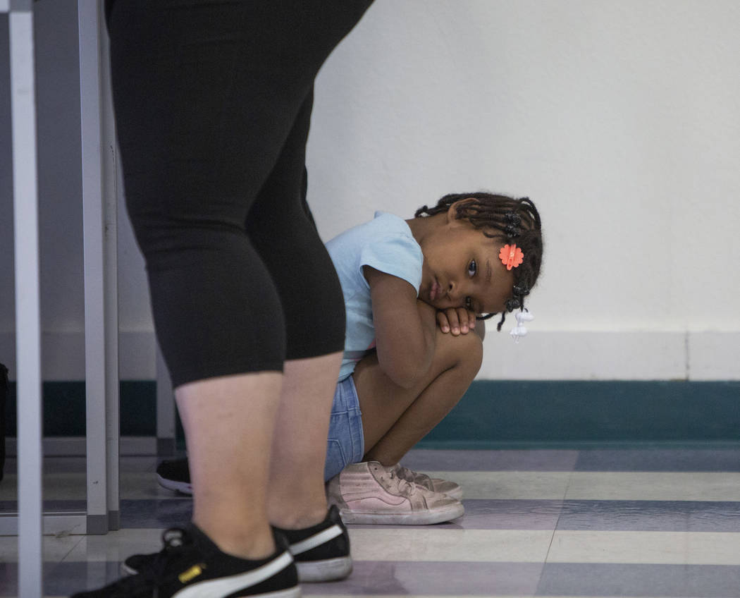 Zariyah Tinsley, 4, waits as her mother casts her ballots at a polling station at Raul Elizondo Elementary School in North Las Vegas, Tuesday, Nov. 6, 2018. Caroline Brehman/Las Vegas Review-Journal