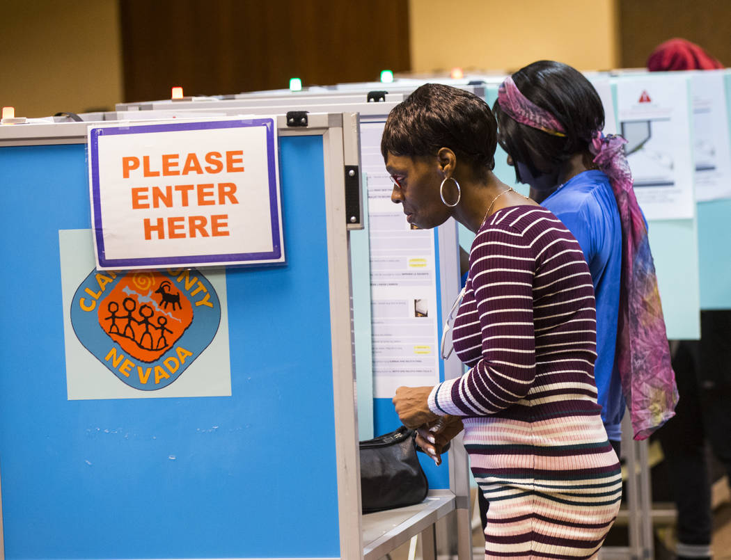 Andrea Saffore looks over her ballot at a polling station at the Regional Transportation Commission building in downtown Las Vegas on Tuesday, Nov. 6, 2018. Chase Stevens Las Vegas Review-Journal ...