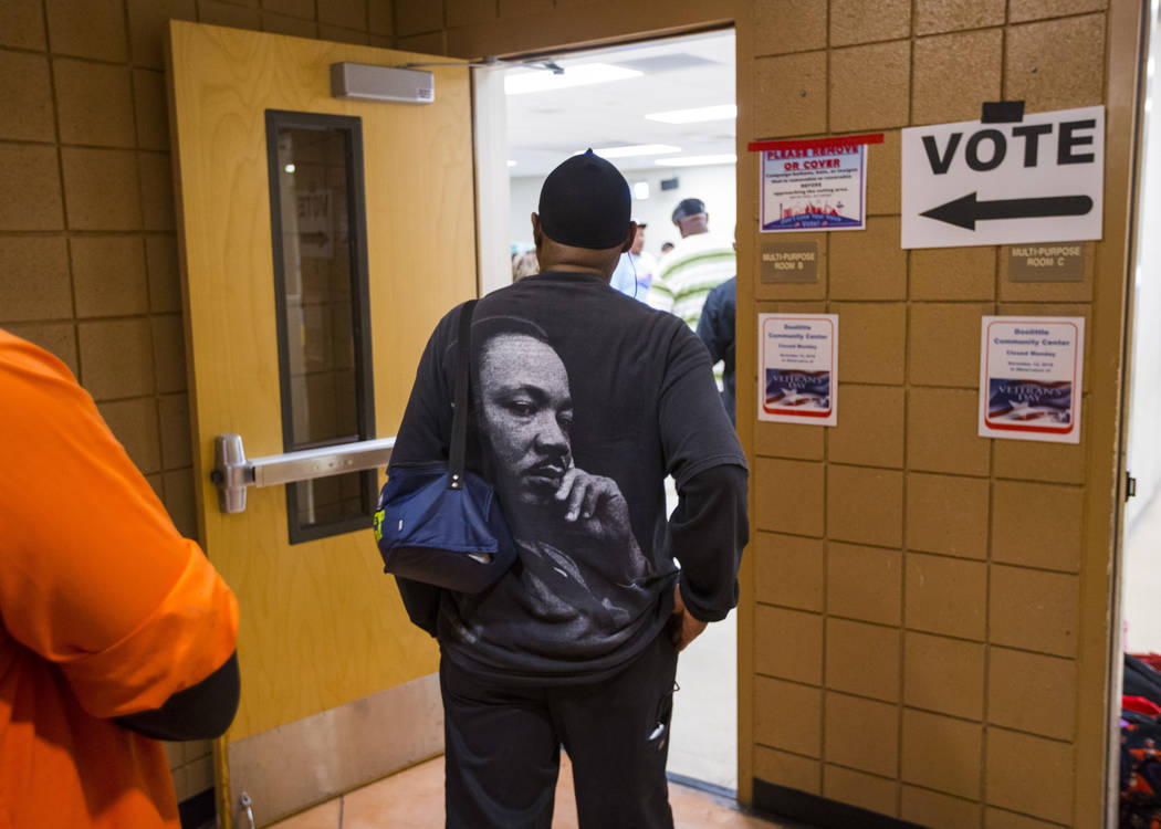 James Givens waits in line to vote at a polling station at Doolittle Community Center in Las Vegas on Tuesday, Nov. 6, 2018. Chase Stevens Las Vegas Review-Journal @csstevensphoto
