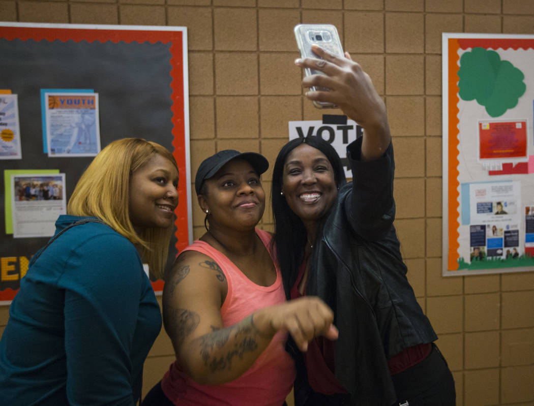 Roshanda Potter, from left, Deandra Jones, and Stephanie Berry pose for a selfie while in line to vote at a polling station at Doolittle Community Center in Las Vegas on Tuesday, Nov. 6, 2018. Cha ...