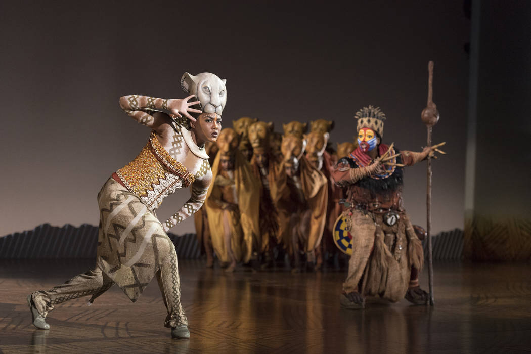 """Nia Holloway as Nala, Buyi Zama as Rafiki and The Lionesses are shown in """"The Lion King"""" North American Tour. (Disney / Deen van Meer)"""