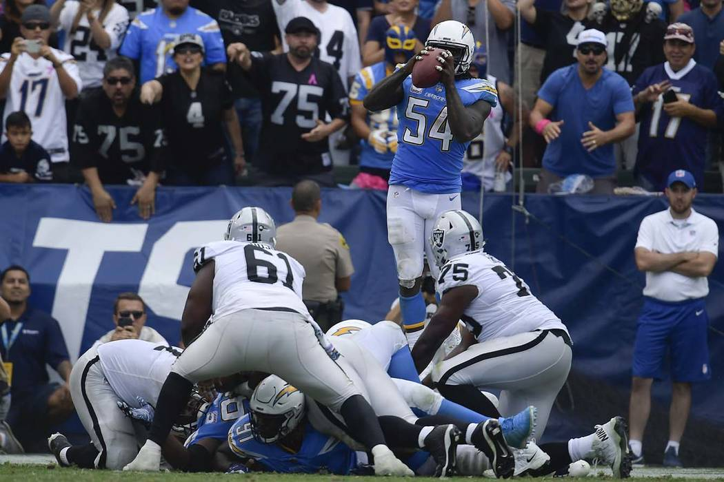 Los Angeles Chargers defensive end Melvin Ingram intercepts a pass during the second half of an NFL football game against the Oakland Raiders Sunday, Oct. 7, 2018, in Carson, Calif. (Mark J. Terri ...