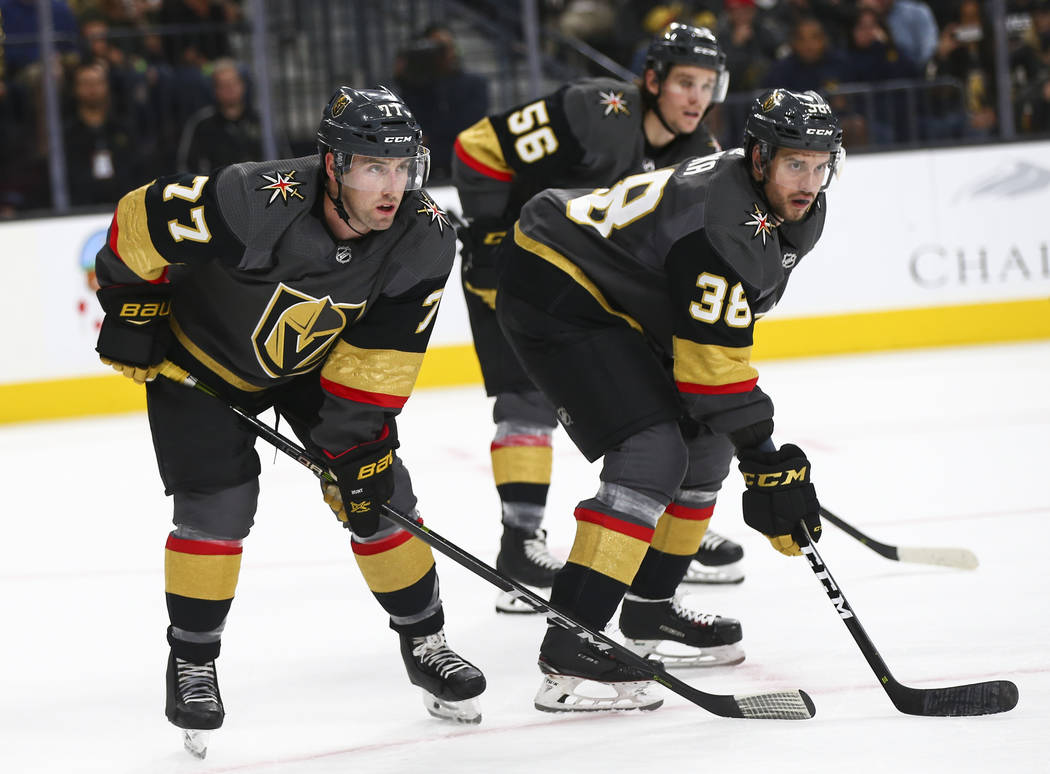 Golden Knights defenseman Brad Hunt (77) and Golden Knights right wing Tomas Hyka (38) look on during the second period of an NHL hockey game against the Carolina Hurricanes at T-Mobile Arena in L ...