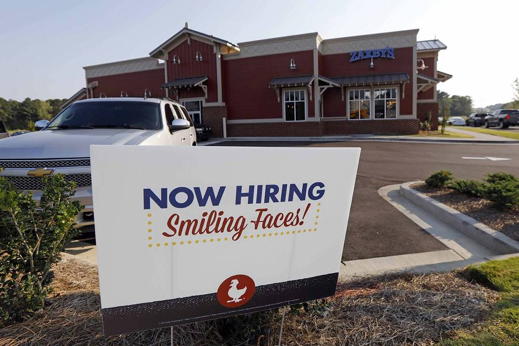 A help wanted sign at a new Zaxby's restaurant in Madison, Miss., July 25, 2018. On Tuesday, Nov. 6, 2018, the Labor Department reports on job openings and labor turnover for September. (Rogelio V ...
