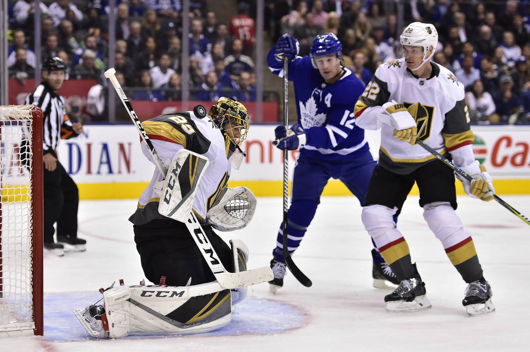 Vegas Golden Knights goaltender Marc-Andre Fleury (29) makes a save as Toronto Maple Leafs center Patrick Marleau (12) looks for a rebound and Golden Knights defenseman Nick Holden (22) defends du ...