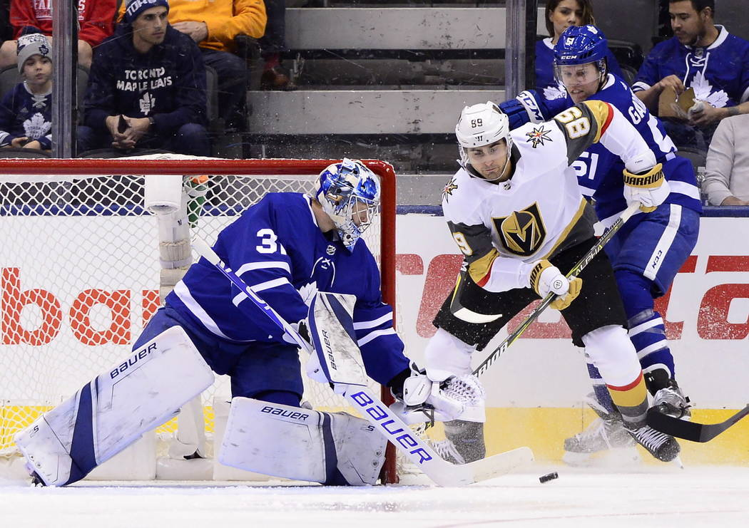 Toronto Maple Leafs goaltender Frederik Andersen (31) looks to the puck Maple Leafs defenseman Jake Gardiner (51) battles Vegas Golden Knights right wing Alex Tuch (89) during the first period of ...