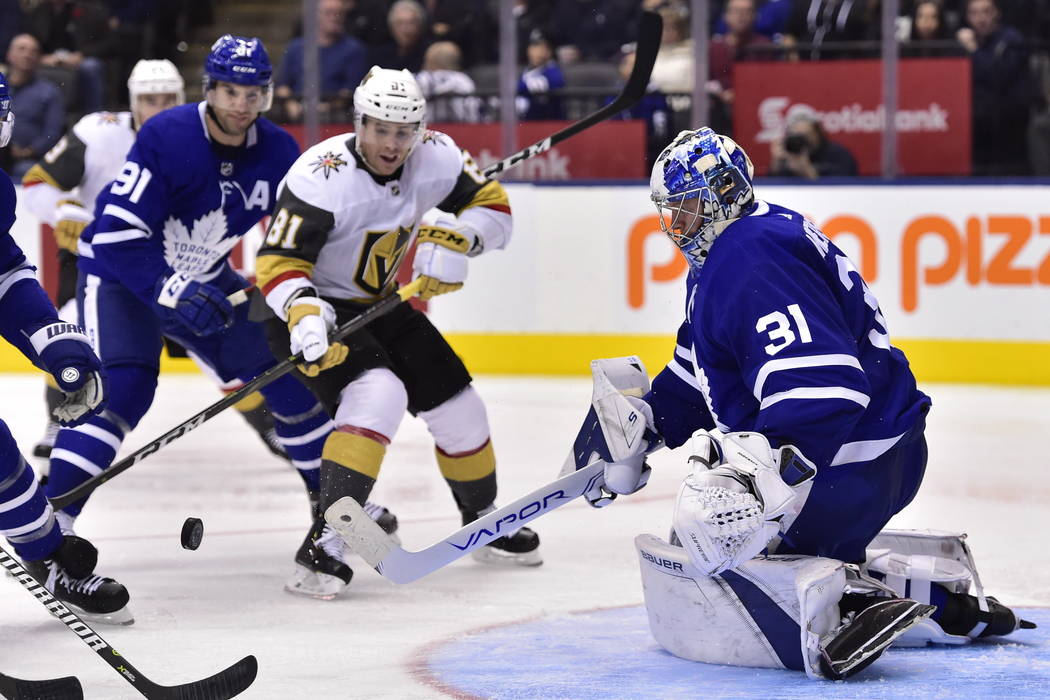 Toronto Maple Leafs goaltender Frederik Andersen (31) watches the puck as Vegas Golden Knights center Jonathan Marchessault (81) looks for a rebound during the third period of an NHL hockey game T ...