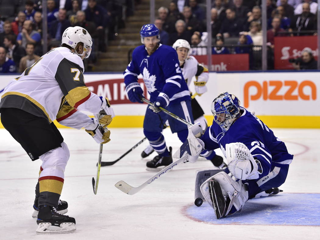 Toronto Maple Leafs goaltender Frederik Andersen (31) stops Vegas Golden Knights center William Karlsson (71) during the third period of an NHL hockey game Tuesday, Nov. 6, 2018, in Toronto. (Fran ...