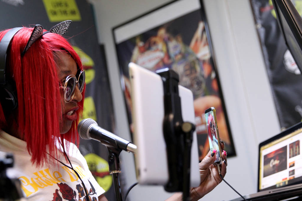 """DeVonna """"Kat"""" Normand engages with a listener live on Instagram during her Sin City Heat show at 22.3 TakeOver Vegas Radio internet radio station in Las Vegas Friday, Nov. 9, 2018. Norma ..."""