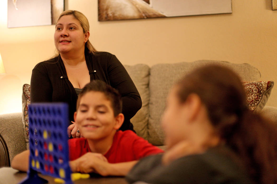 Lorena Llamas speaks to the Review-Journal near her children at her home in North Las Vegas, Thursday, Nov. 8, 2018. Llamas is one of thousands of women who have claimed to have suffered chronic a ...