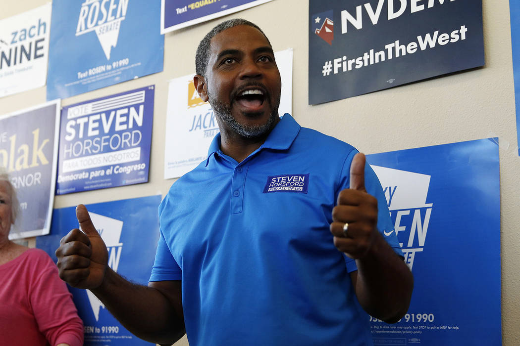 Steven Horsford, Democratic candidate for Nevada's fourth congressional district, visits a Democratic office on election day Tuesday, Nov. 6, 2018, in Las Vegas. (AP Photo/John Locher)