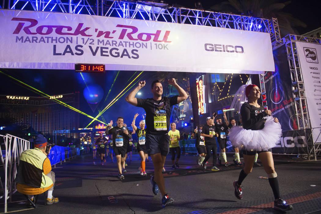 Participants cross the finish line during the Rock 'n' Roll Las Vegas Marathon on Nov. 12. (Sam Morris Las Vegas News Bureau)