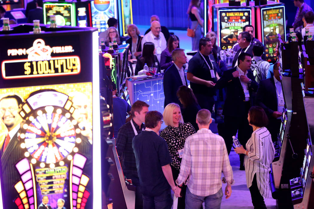 Conventioneers mingle in the Everi Games booth at the 18th annual Global Gaming Expo at Sands Expo and Convention Center in Las Vegas Tuesday, Oct. 9, 2018. G2E runs through Thursday. K.M. Cannon ...