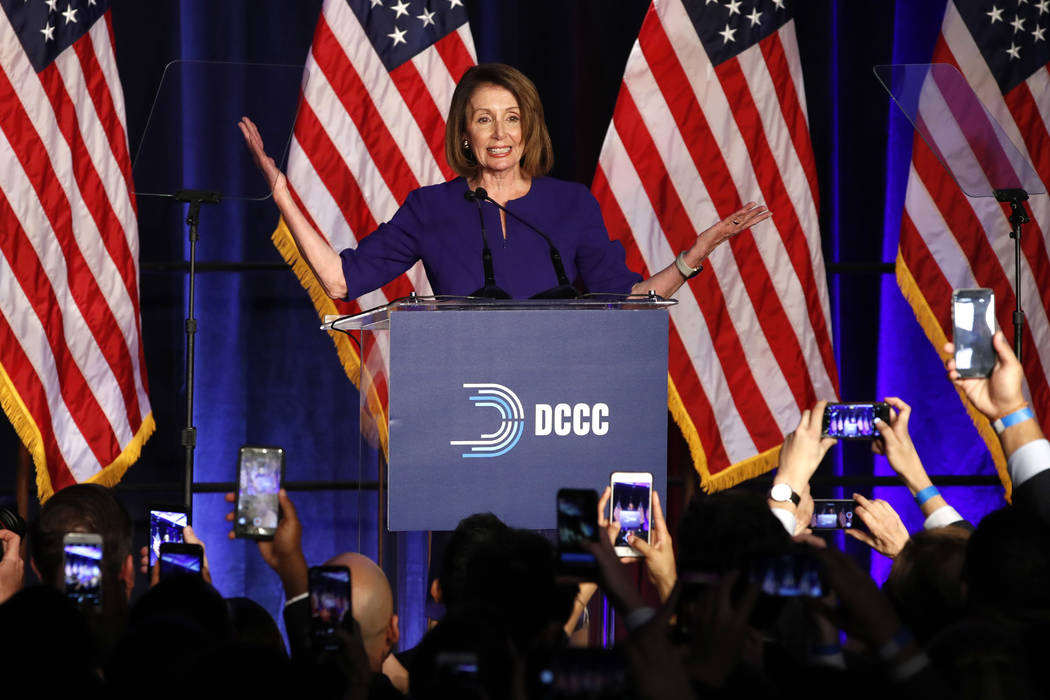 House Minority Leader Nancy Pelosi of Calif., smiles as she is cheered by a crowd of Democratic supporters during an election night returns event at the Hyatt Regency Hotel, on Tuesday, Nov. 6, 20 ...