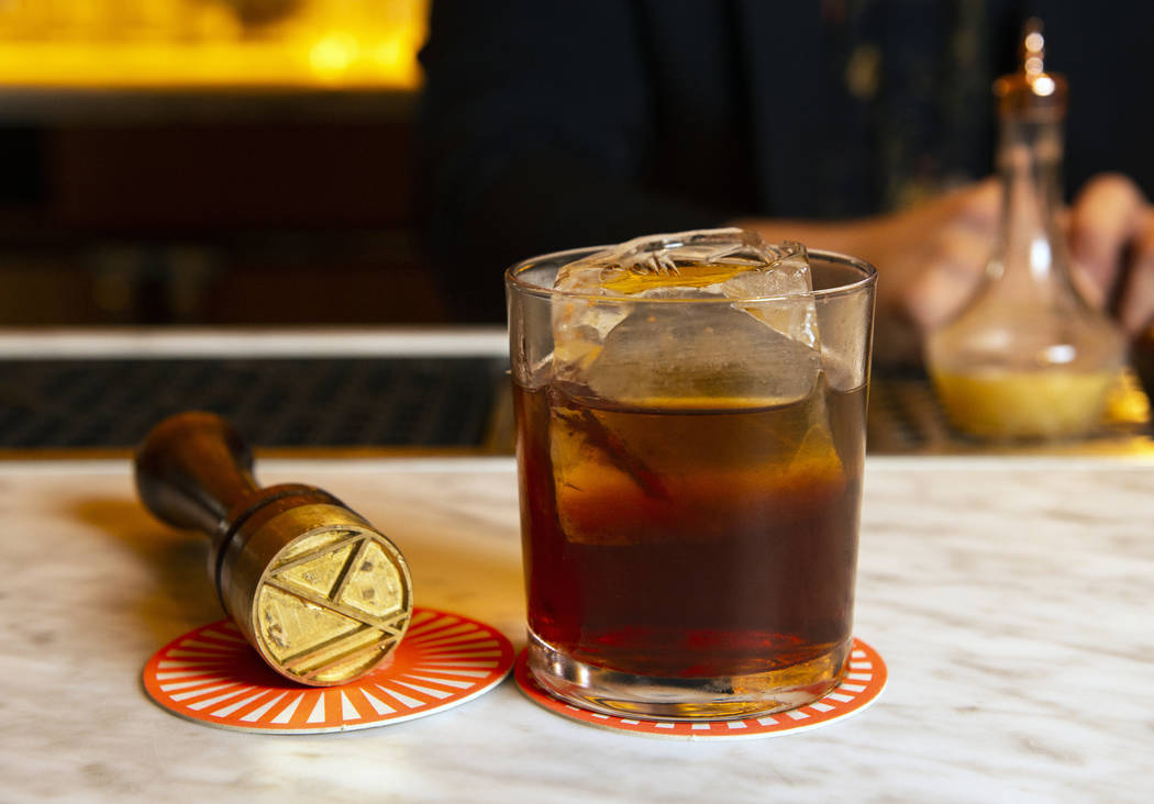 "The ""Detox-retox"" cocktail is made up of blended scotch, Venezuelan rum, pineapple rum, aged cachaca, coconut water, angostura fee, and absinthe at the NoMad Bar and Restaurant in Park MGM in Las ..."