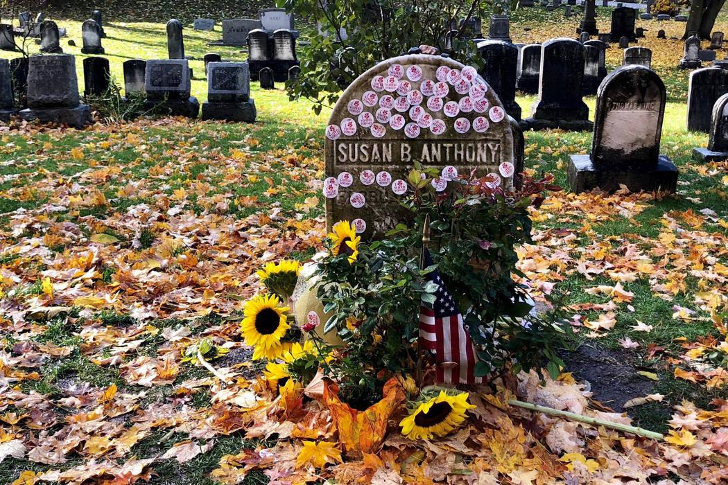 """Susan B. Anthony's grave decorated with 'I Voted' stickers in Rochester, N.Y., Tuesday, Nov. 6, 2018. Voters showed up by the dozens to put their """"I Voted"""" stickers on the headstone, an ..."""