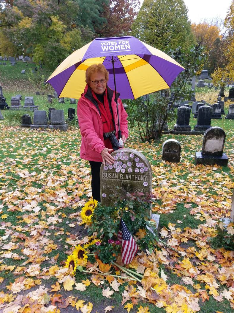 """Emily Jones poses at the grave of Susan B. Anthony in Rochester, N.Y., Tuesday, Nov. 6, 2018. Voters showed up by the dozens to put their """"I Voted"""" stickers on the headstone, an Election Day r ..."""