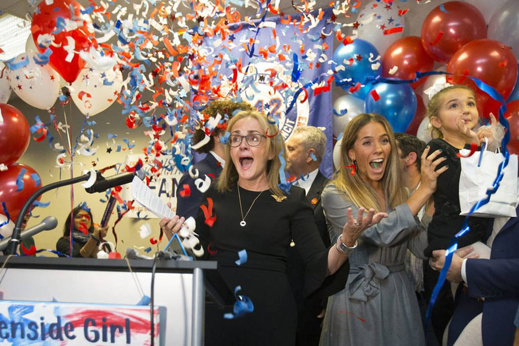 Democrat Madeleine Dean celebrates after winning Pennsylvania's 4th Congressional District race, in Fort Washington, Pa., Tuesday, Nov. 6, 2018. (Charles Fox/The Philadelphia Inquirer via AP)