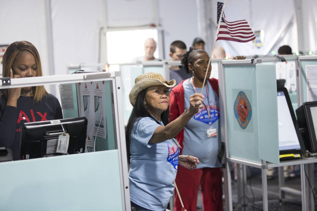 Volunteer Leah Barney, middle, directs voters to open machines at the voting station at 7881 W. Tropical Pkwy. on Tuesday, November 6, 2018, in Las Vegas. Benjamin Hager Las Vegas Review-Journal