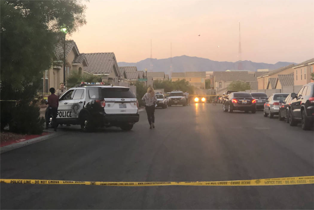 Police investigate the scene of a shooting in the 2600 block of Spider Cactus Court in Las Vegas on Oct. 25, 2018. (Katelyn Newberg/Las Vegas Review-Journal)