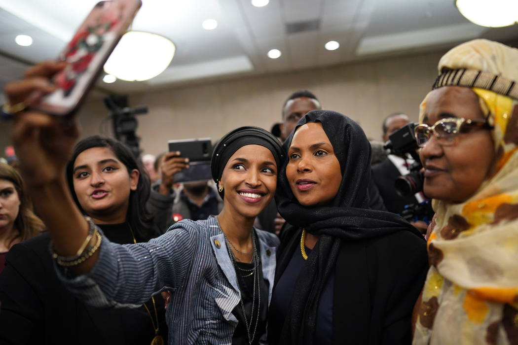 Ilhan Omar poses for a selfies with supporters after her victory Tuesday, Nov. 6, 2018, in Minneapolis. Omar is poised to become the first Somali-American elected to Congress, representing Minneso ...