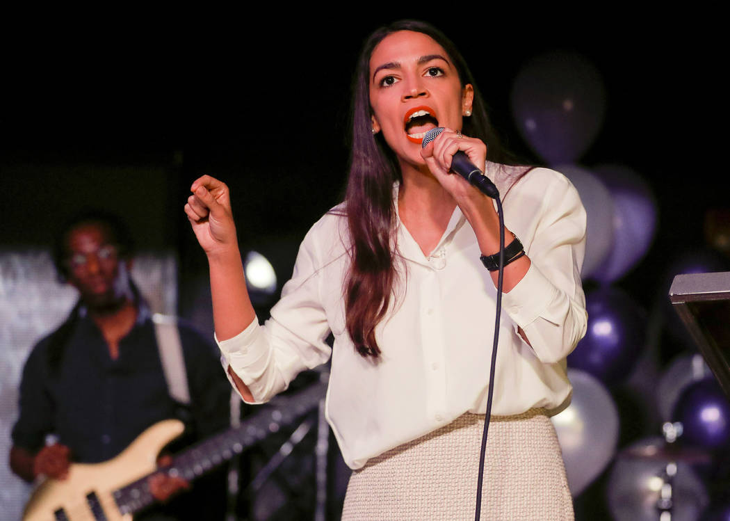 New York Democratic Congressional candidate Alexandria Ocasio-Cortez speaks to supporters, Tuesday, Nov. 6, 2018 in Queens the Queens borough of New York, after defeating Republican challenger Ant ...
