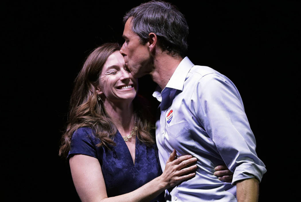 Rep. Beto O'Rourke, D-Texas, the 2018 Democratic Candidate for U.S. Senate in Texas, right, kisses his wife, Amy Sanders, at his election night party, Tuesday, Nov. 6, 2018, in El Paso, Texas, aft ...