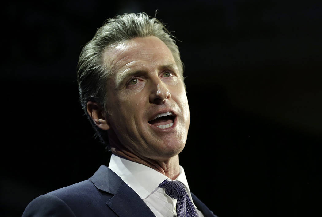 Lt. Gov Gavin Newsom, a Democrat, addresses an election night crowd after he defeated Republican John Cox to become the 40th governor of California Tuesday, Nov. 6, 2018, in Los Angeles. (AP Photo ...