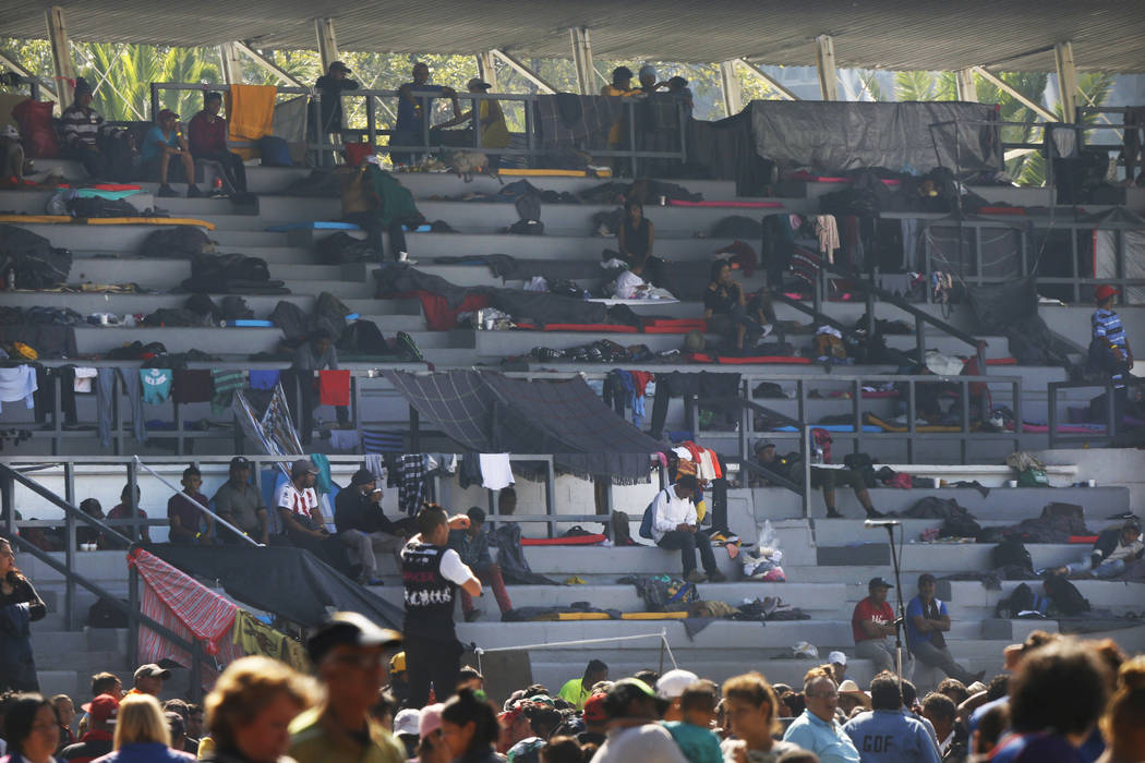 Central American migrants settle in a shelter at the Jesus Martinez stadium in Mexico City, Tuesday, Nov. 6, 2018. Humanitarian aid converged around the stadium in Mexico City where thousands of C ...