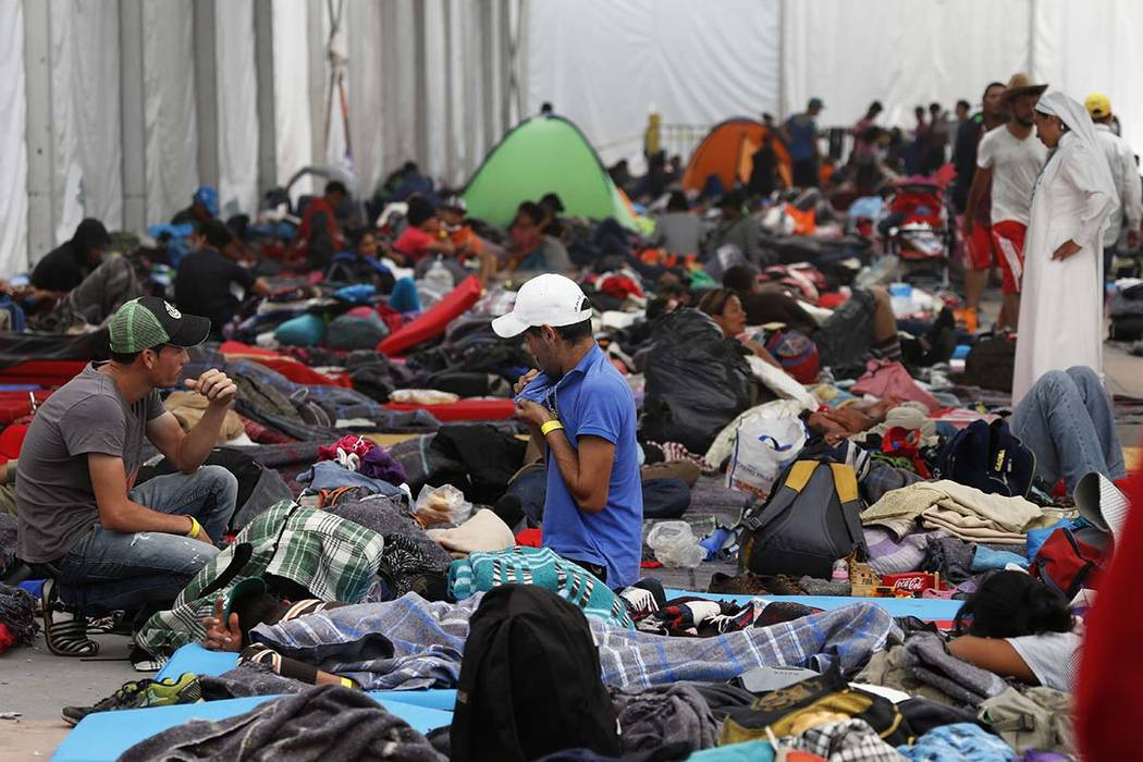 Central American migrants settle in a shelter at the Jesus Martinez stadium in Mexico City, Tuesday, Nov. 6, 2018. (AP Photo/Marco Ugarte)