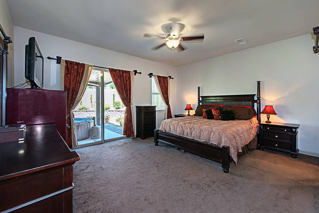 The master bedroom on 4039 Wild Eagle Circle opens to a spa on the patio. (TMI Realty)