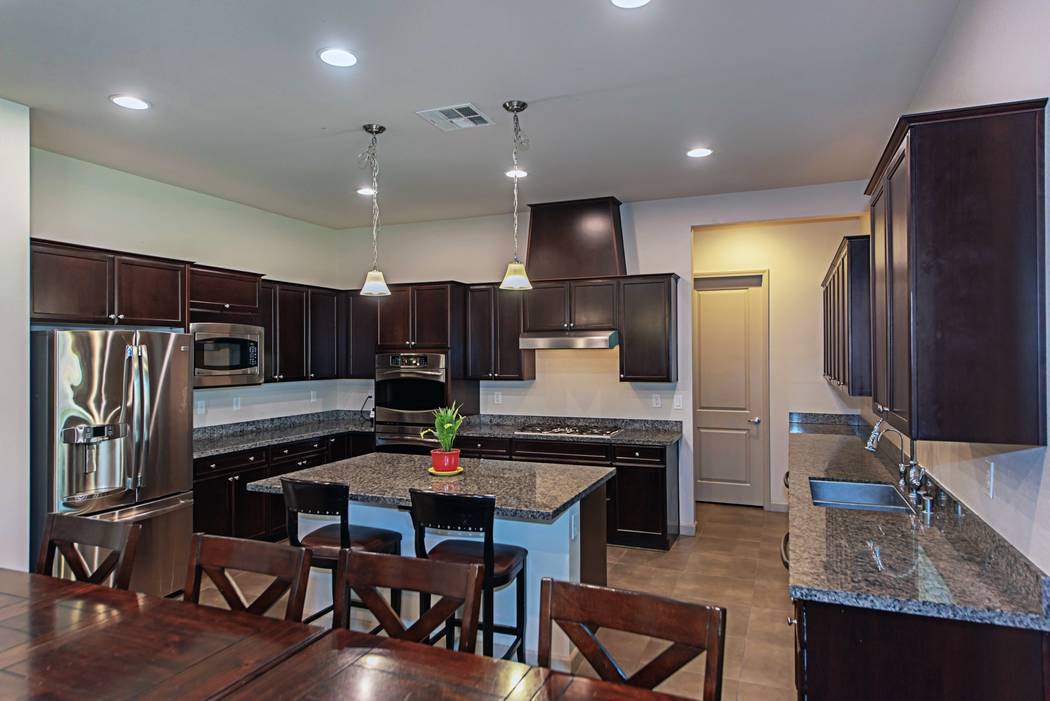 """An upgraded large kitchen is the hub of Christine Brown's home. She appears in the TV series """"Sister Wives."""" (TMI Realty)"""