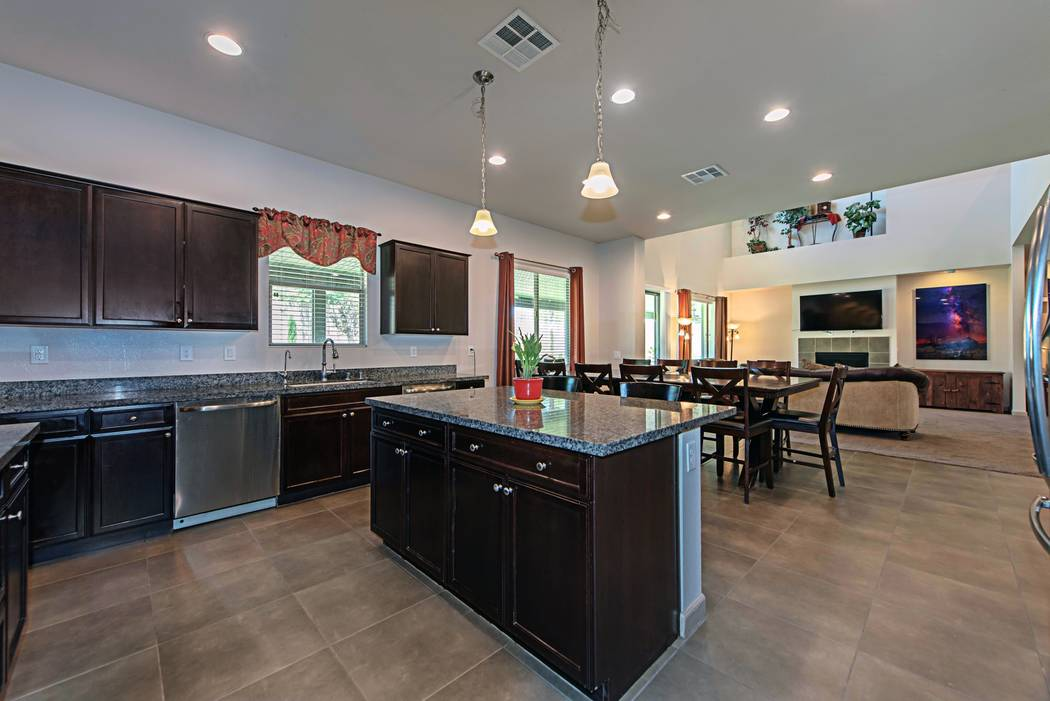 The kitchen in 4039 Wild Eagle is large and has an adjacent dining room. (TMI Realty)