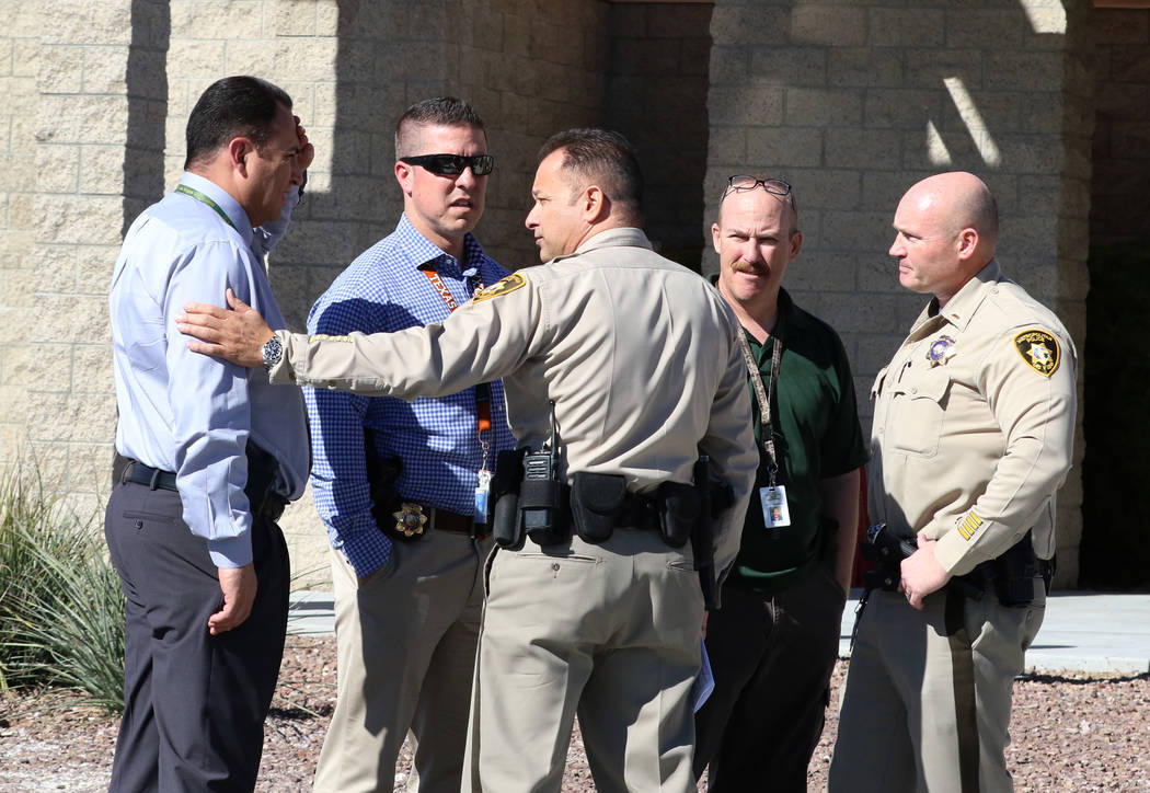 Capt. Laz Chavez, center, who oversees the Metropolitan Police Department's downtown area command, chats with officers prior to speaking at a press conference on Wednesday Nov. 7, 2018, in Las V ...