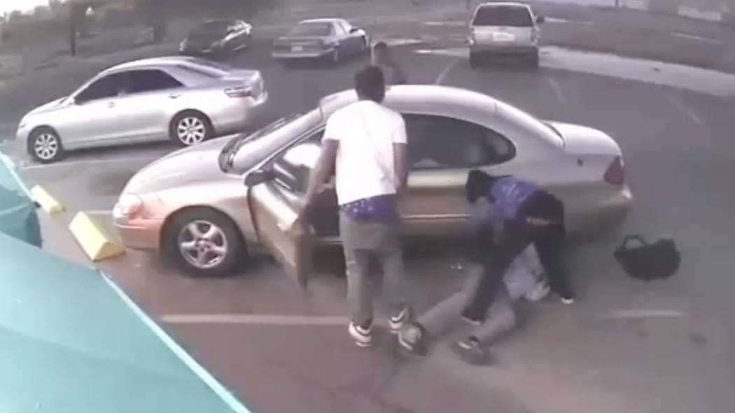 Las Vegas police are looking for 3 suspects who beat a 78-year-old man and took his vehicle Tuesday evening near downtown Las Vegas. (LVMPD)