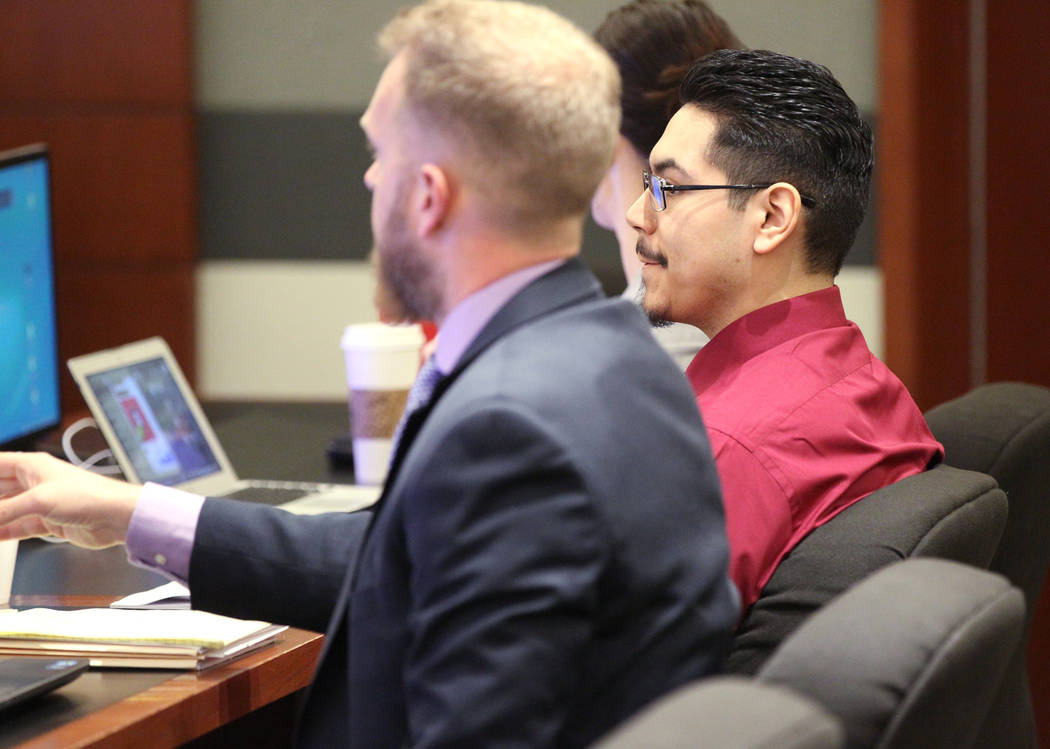 Casey Sandoval, who fatally shot his girlfriend, Ariele Azrate-Lujan in 2015, waits for closing arguments with his attorneys Robert O'Brien and Tegan Machnich in his murder trial in Clark County D ...
