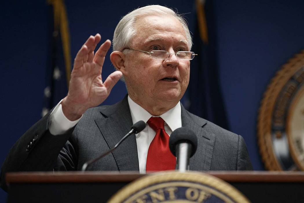 Attorney General Jeff Sessions speaks during a news conference at the U.S. Attorney's Office for the District of Columbia in Washington, Monday, Oct. 15, 2018, to announce on efforts to reduce tra ...