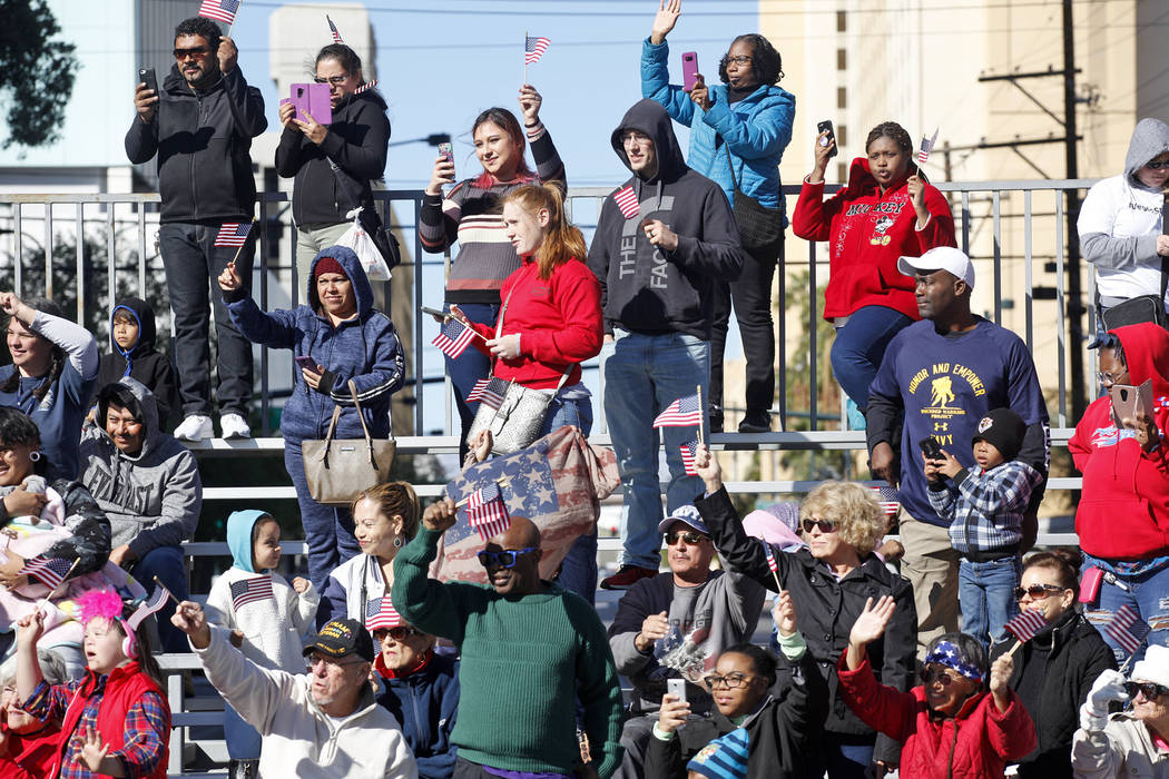 A crowd cheers on during the Veterans Day Parade in downtown Las Vegas, Sunday, Nov. 11, 2018. Rachel Aston Las Vegas Review-Journal @rookie__rae