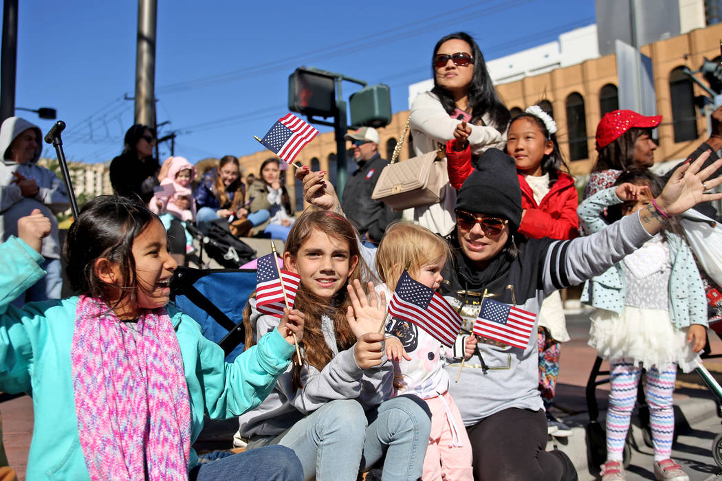 Eva Rodriguez, from left, Kaylee Boxford, 9, Alana Boxford, 2, and Liz Boxford cheer for the floats at the Veterans Day Parade in Las Vegas, Sunday, Nov. 11, 2018. Rachel Aston Las Vegas Review-Jo ...