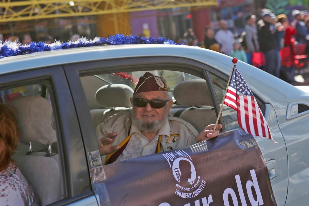Vincent Shank, a World War II veteran, 102, waves during the Veterans Day Parade in Las Vegas, Sunday, Nov. 11, 2018. Rachel Aston Las Vegas Review-Journal @rookie__rae