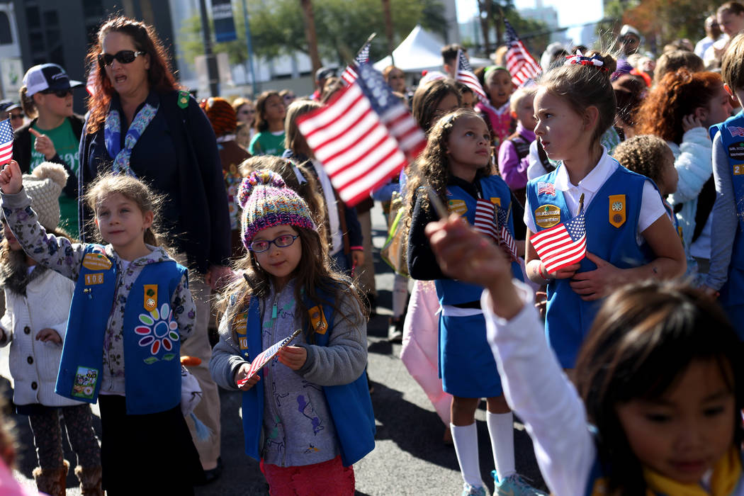 Girl Scouts cheer during the Veterans Day Parade procession in Las Vegas, Sunday, Nov. 11, 2018. Rachel Aston Las Vegas Review-Journal @rookie__rae
