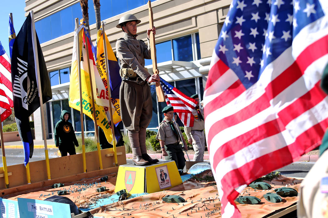 The Boy Scout float during the Veterans Day Parade in Las Vegas, Sunday, Nov. 11, 2018. The Troop recreated the Meuse-Argonne Offensive from World War I with G.I. Joes. On the sides of the float w ...