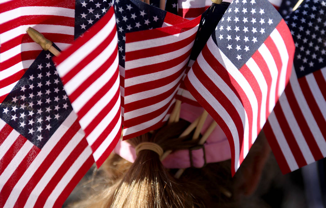 Connie Foster shows off her hat filled with flags during the Veterans Day Parade in Las Vegas, Sunday, Nov. 11, 2018. Rachel Aston Las Vegas Review-Journal @rookie__rae